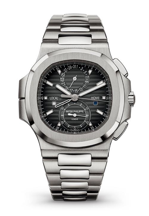 百達翡麗 Patek Philippe Nautilus Travel Time Chronograph Ref. 5990/1A 不鏽鋼錶殼造型簡潔時尚。設有兩根時針,鏤空時針指示原居地時間,實心時針指示當地時間。當不需要雙時區顯示時,兩根時針可以重合運轉。另設有兩地晝夜顯示窗,60分鐘計時和指針式當地日期顯示功能。防水深度達120米。 patek.com, At Brinkhaus Jewellers, 604 689 7055