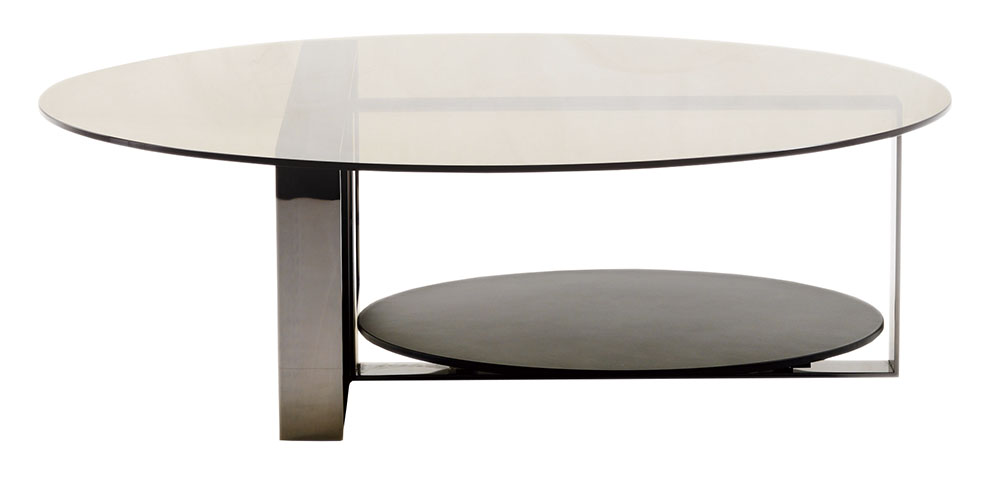 Minotti Bresson Coffee Table Price Upon Request 激光切割的金屬底座,劃分出獨特的不對稱視覺效果,巧妙地承托起玻璃桌面,另有方形的桌面可供選擇。 At Livingspace, (877) 683-1116 livingspace.com