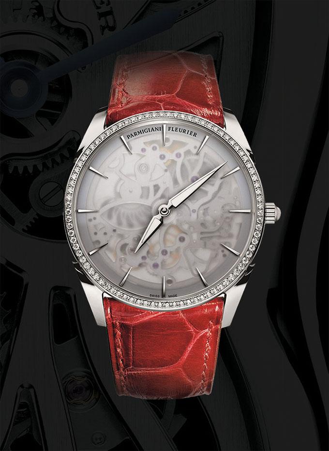 Parmigiani Tonda 1950 Squelette 帕瑪強尼最成功的Tonda 1950系列今年推出了鏤空錶款。僅為2.6mm的機芯厚度,將鏤空腕錶的技藝再次推向極致。這款鏤空女士錶以細緻的磨砂錶盤為特色,讓鏤空腕錶的含蓄之美更添一份朦朧。機芯的硬朗稜角也由此呈現出柔和之感,凸顯出女性的細膩情懷。18K白金錶殼,紅色鱷魚皮錶帶,動力儲存42小時,防水30米。 parmigiani.com, at Palladio, (604) 685-3885