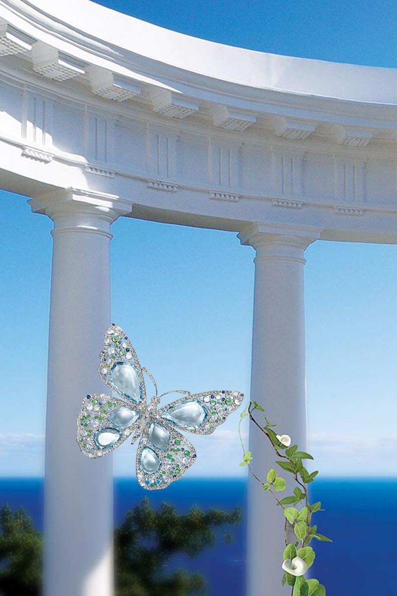 蒂芙尼蝴蝶胸針 海映天澄淨 翠蝶舞輕靈 鉑金鑲嵌海藍寶石、鑽石和各色寶石。  Price: $115,000, 800.843.3269, Tiffany.com