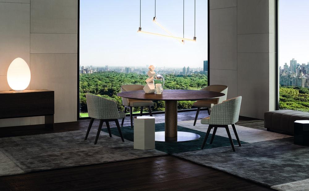 簡潔的現代風格木質圓桌  Minotti Bellagio Dining Wood Round Table, Starting at $12,689, Creed Dining Armchair, Starting at $3,659 At Livingspace, (877) 683-1116, livingspace.com