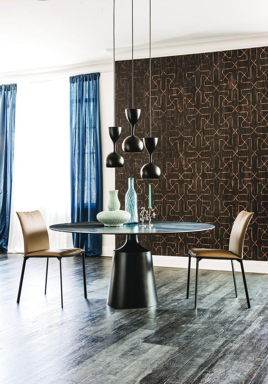 金屬底座,天然石材桌面的現代圓桌  Cattelan Italia Yoda Dining Table, Starting at $6,339 At Livingspace, (877) 683-1116, livingspace.com