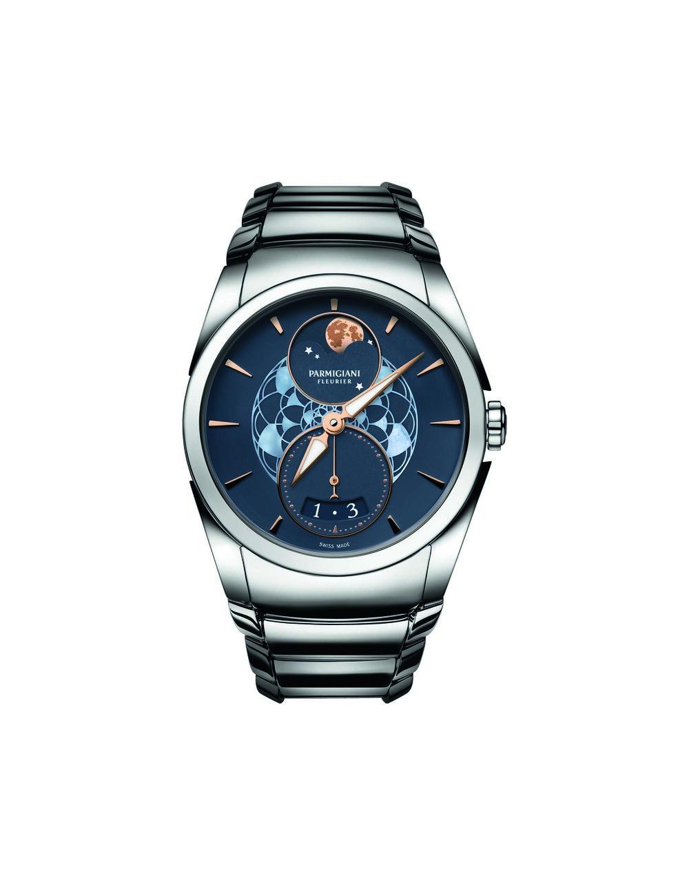Tonda Metropolitaine Selene  帕瑪強尼Tonda系列「都市月之女神」女士腕錶於今年日內瓦鐘錶展(SIHH)上推出,機芯完全由帕瑪強尼獨自研發,造型簡約經典,但於細節處盡顯用心。錶盤上青銅打造的月亮呈現獨特的赤褐色,是月亮在特殊雲層條件下才會顯現的光暈。表面栩栩如生的隕石坑,又稱「月海」,為分層打磨描繪而成,手工技藝極為複雜。中央的蓮花圖案由兩層疊加的珍珠貝母雕刻而成,烘托出女性柔美的氣質。六點鐘位置為小秒針和日期顯示窗。雙發條盒,動力儲存50小時。防水30米。另有白色錶盤和皮質錶帶款可供選擇。  At Palladio, (604) 685-3885, parmigiani.com