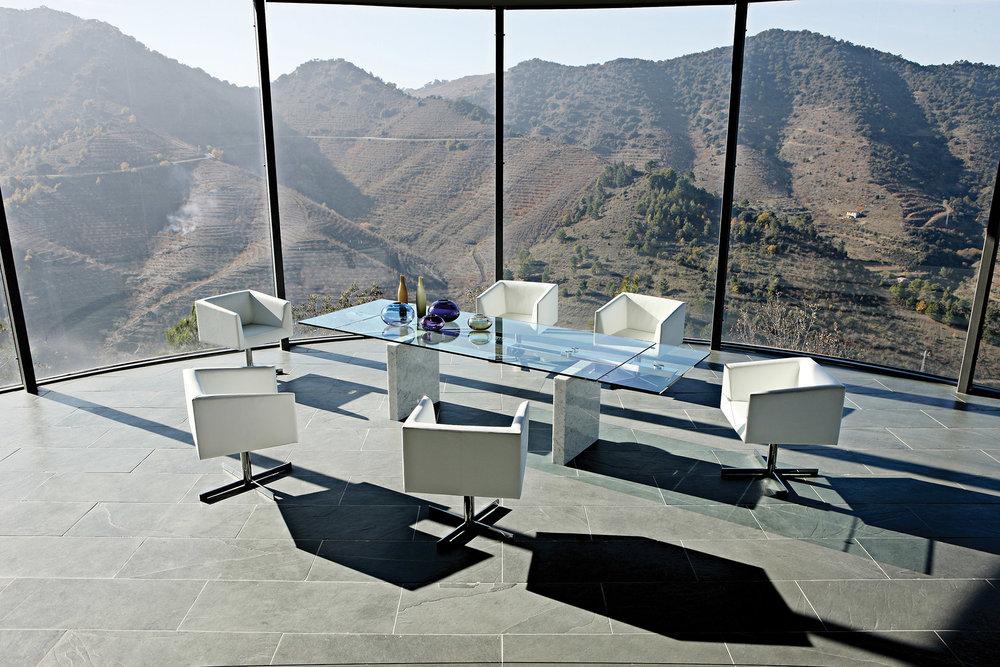 大理石底座玻璃桌面餐桌 $9,935  方形旋轉扶手椅$2,025  At Roche Bobois, (604) 633-5005,  roche-bobois.com