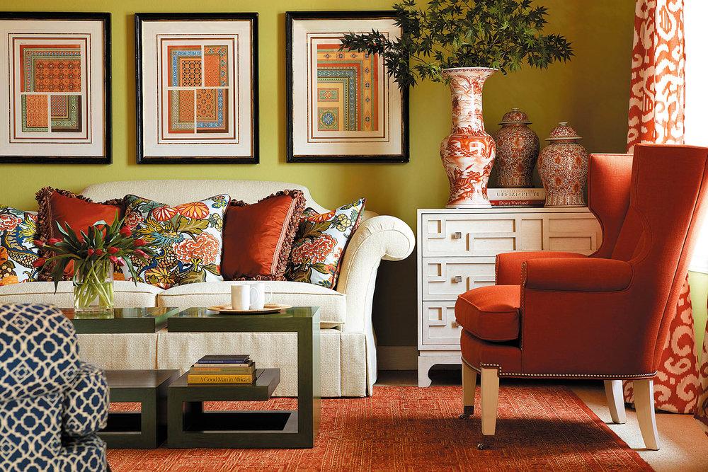 白色布藝沙發與鮮花圖案抱枕、紅色扶手椅  At Paramount Furniture, (604) 273-0155 paramountfurniture.ca
