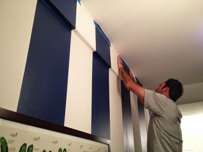 how to paint stripes, tips for painting stripes on walls, navy and blue wall stripes