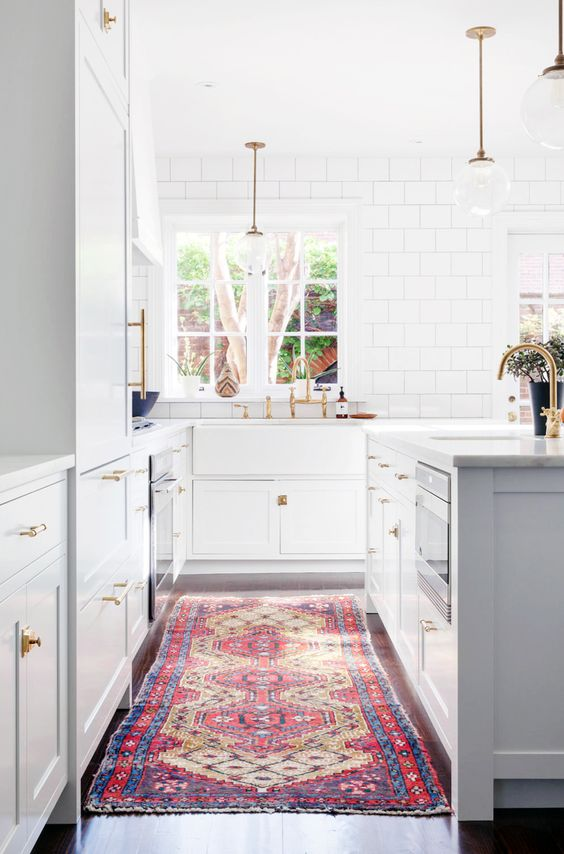 Colorful oriental rug in white and gray kitchen