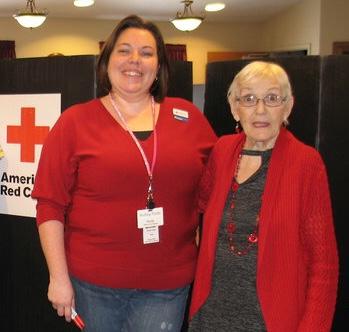 Nicole Hyatt, HR Car Partner, and Nancy Milner, Elder, serve as event volunteers