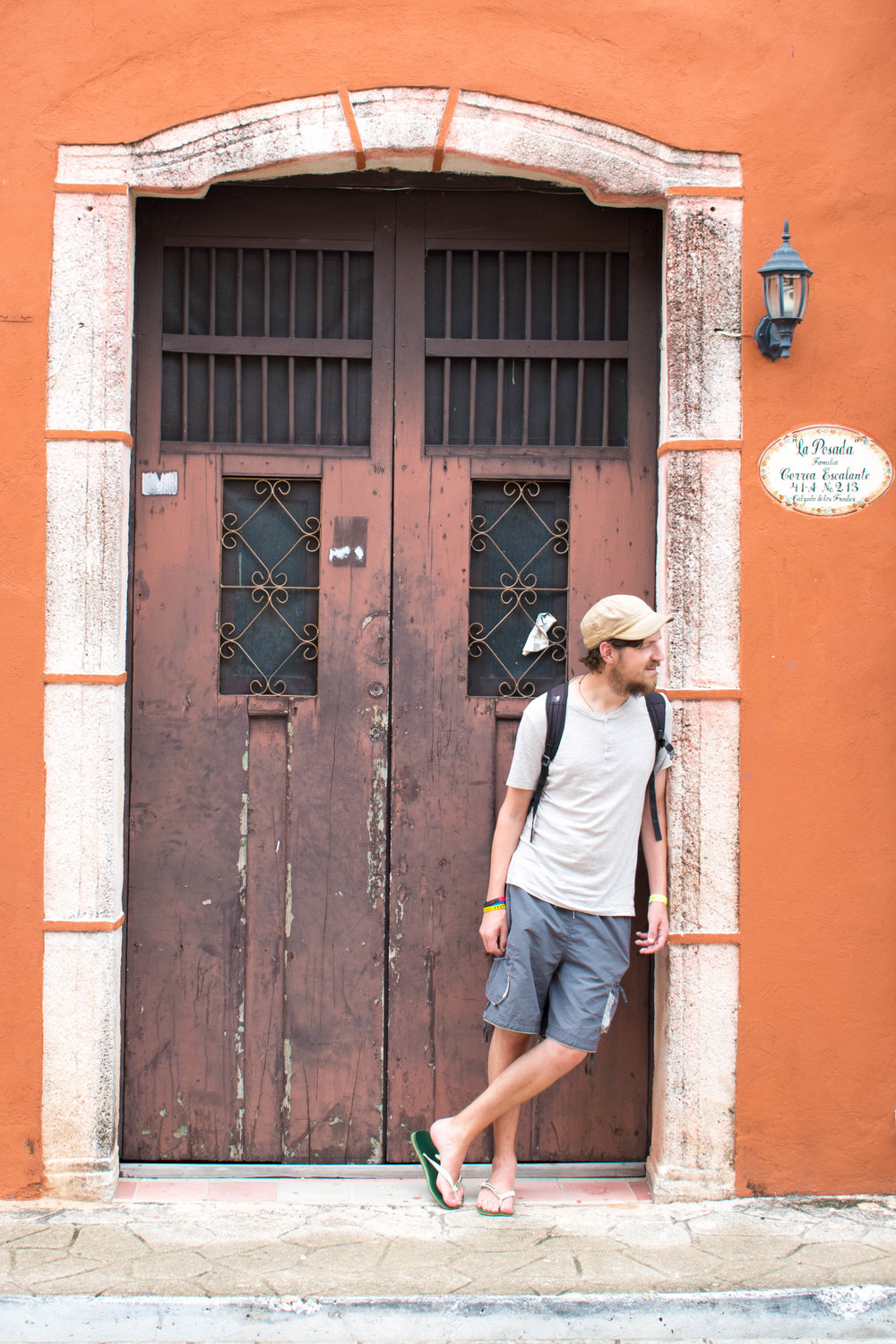 Craig in A Colourful Doorway in Valladolid in Mexico