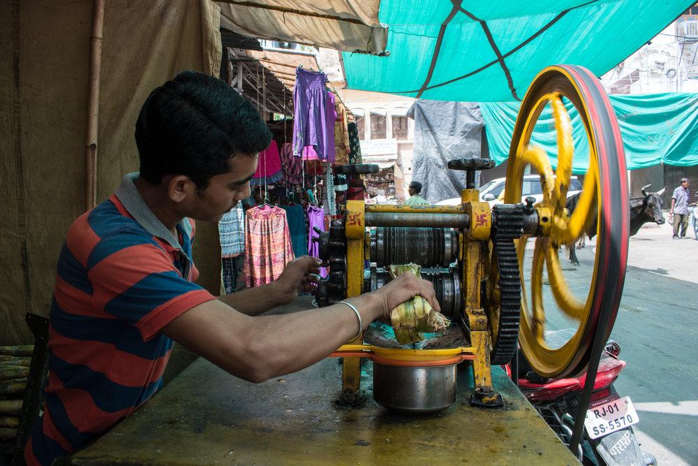 A Local Man Makes Fresh Sugar Cane Juice In Pushkar, India