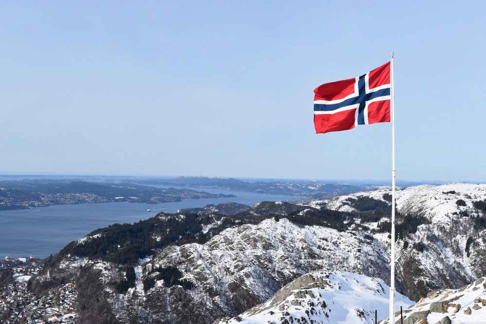 Norwegian Flag Flying On Top Of Mount Ulriken in Bergen, Norway