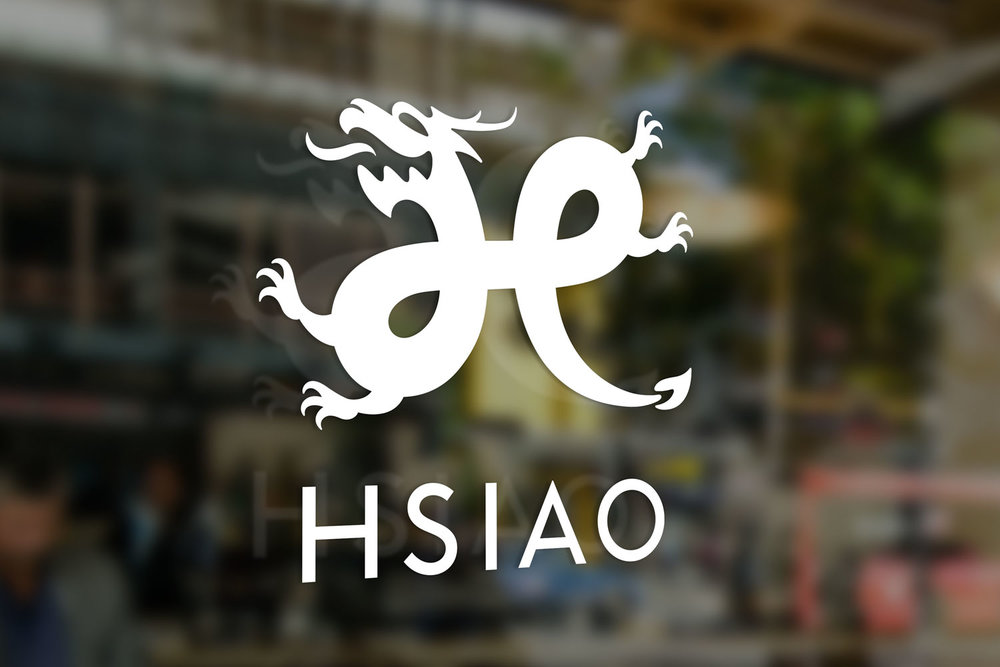 Hsiao Restaurant Group logo decal on storefront