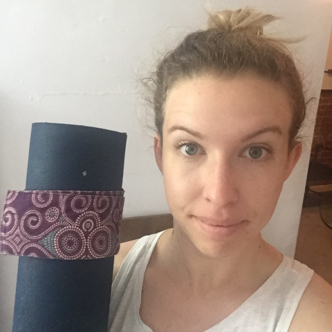 This is a selfie with my yoga mat. One eyebrow is raised higher than the other. It was a sign that I didn't actually want to go.