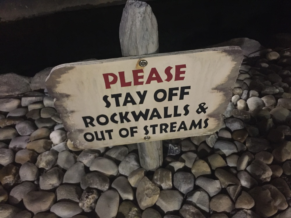 Don't even think about climbing on that rockwall you fuckers