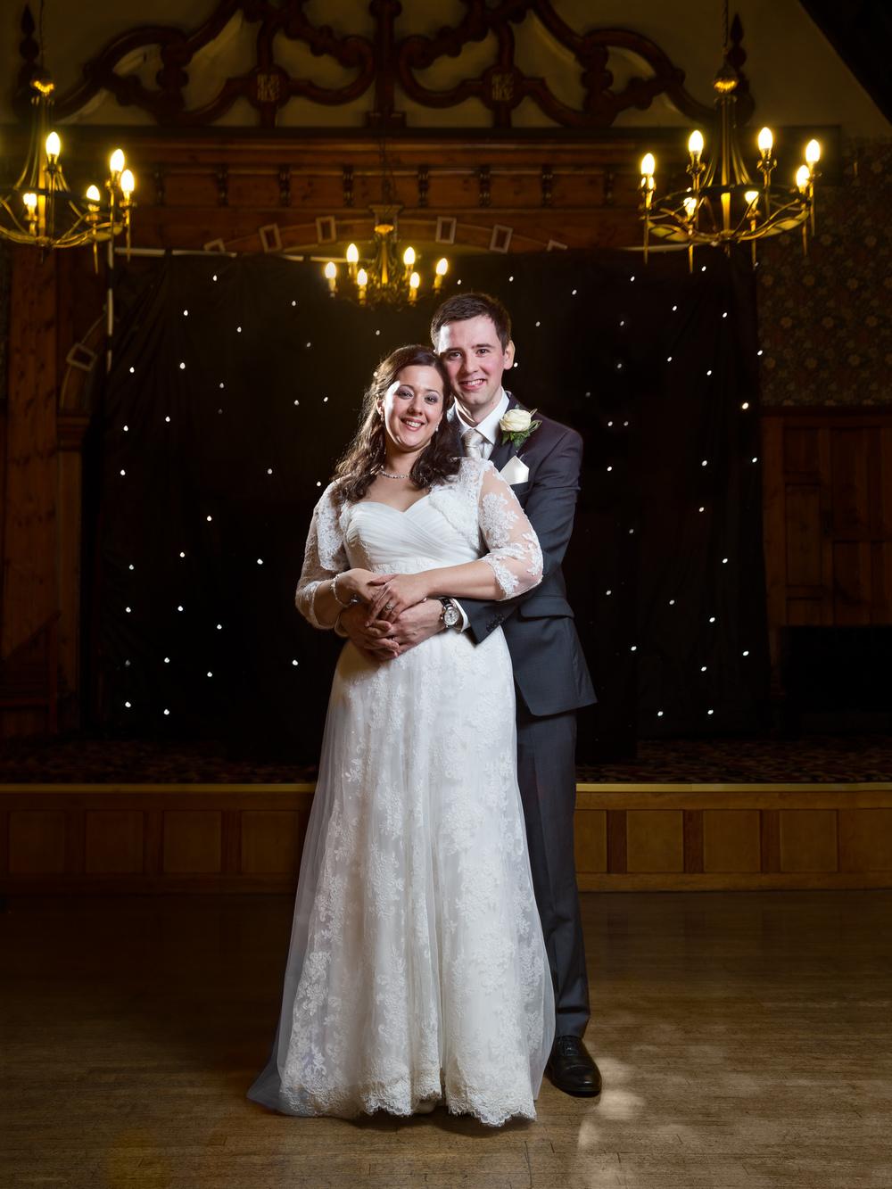 off camera flash photograph at wedding reception