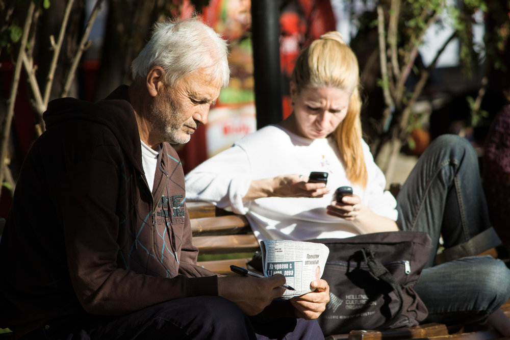 sofia-4308_man-reading-paper-woman-reading-sms.jpg