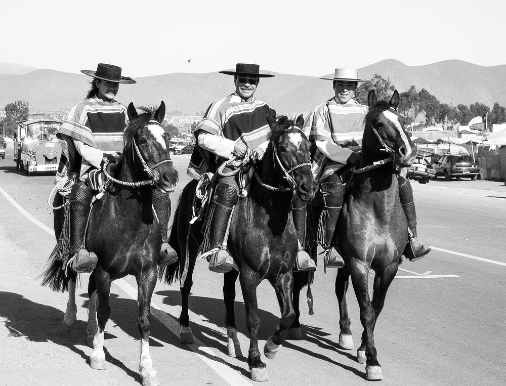 la-serena_and_pisco-elqui-0679-_three-horse-riders-in-traditional-ponchos.jpg