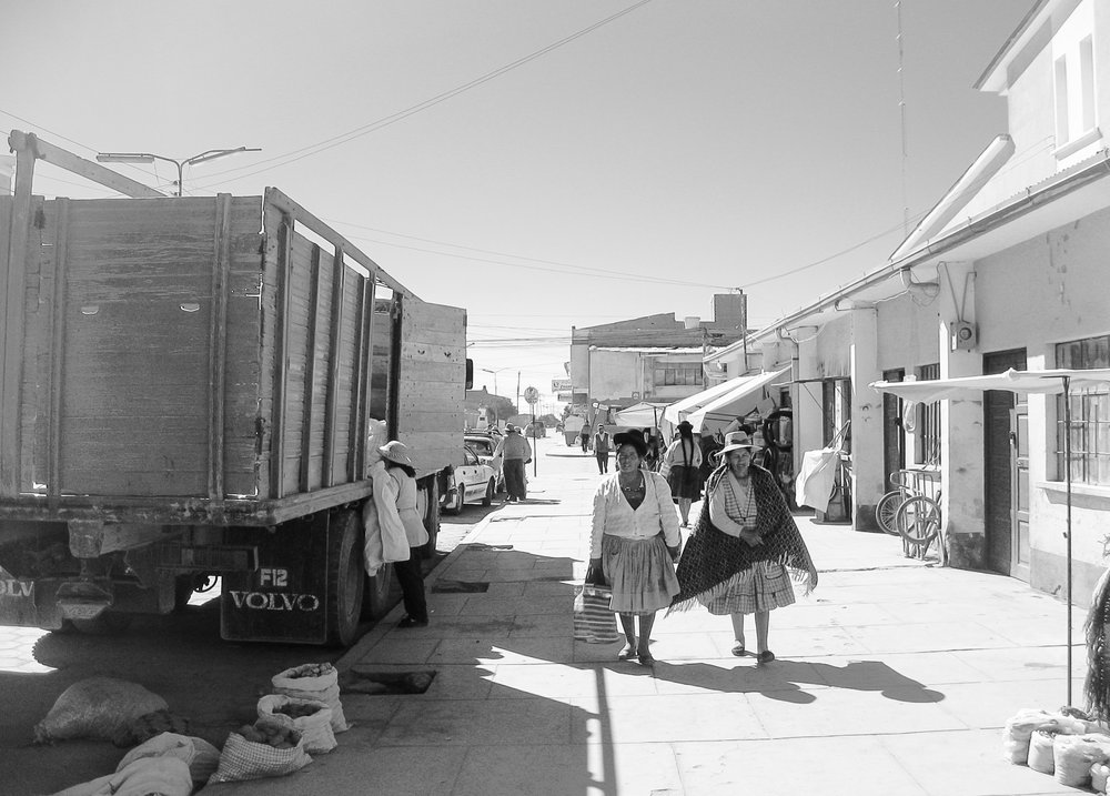 uyuni_salt-flats_day1-8672-_two-peruvian-ladies-walking-on-pavement.jpg