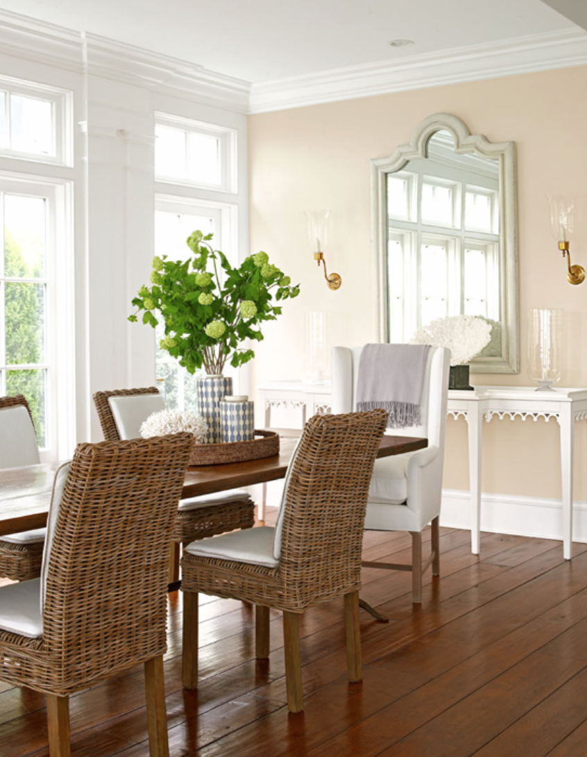 love the rattan chairs mixed with the large upholstered arm chair at the head of the table