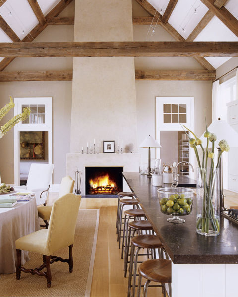 I LOVE ALL THE LAYERED WARM TONES MIXED WITH THE WOOD BEAMS, STONE COUNTERTOPS, AND STUCCO WALLS.