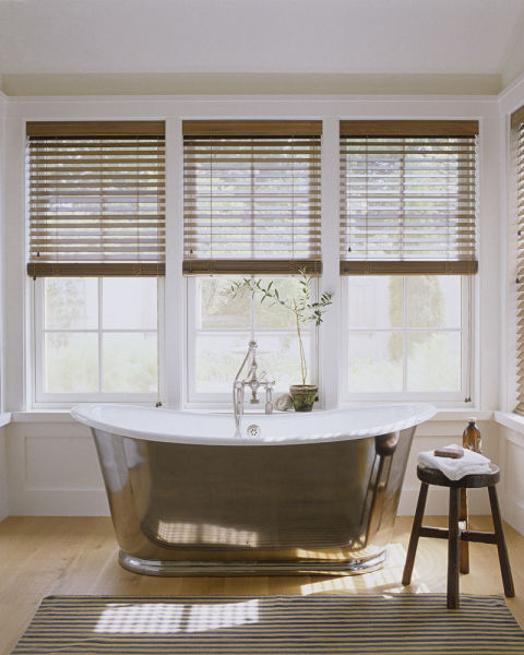 NATURAL LIGHT AND TUBS // ALSO LOVE THE USE OF WOODEN BLINDS AGAINST THE WHITE WALLS- CREATES A GREAT CONTRAST FOR the EYE BUT ALSO 1) ALLOWS FOR GREATER LIGHT CONTROL AND 2) CONTINUES THE ORGANIC FEEL OF THE HOUSE (READ: BARN)
