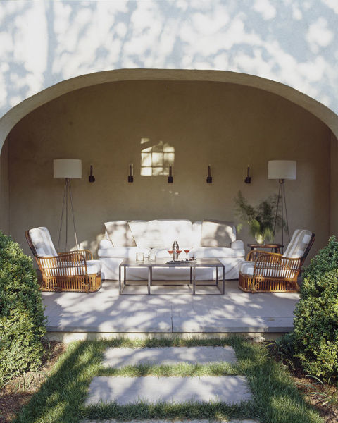 A BEAUTIFUL OUTDOOR SPACE - LOVE THE DRAMATIC TALL FLOOR LAMPS & THE MIX OF THE OUTDOOR SOFA WITH the BAMBOO CHAIRS