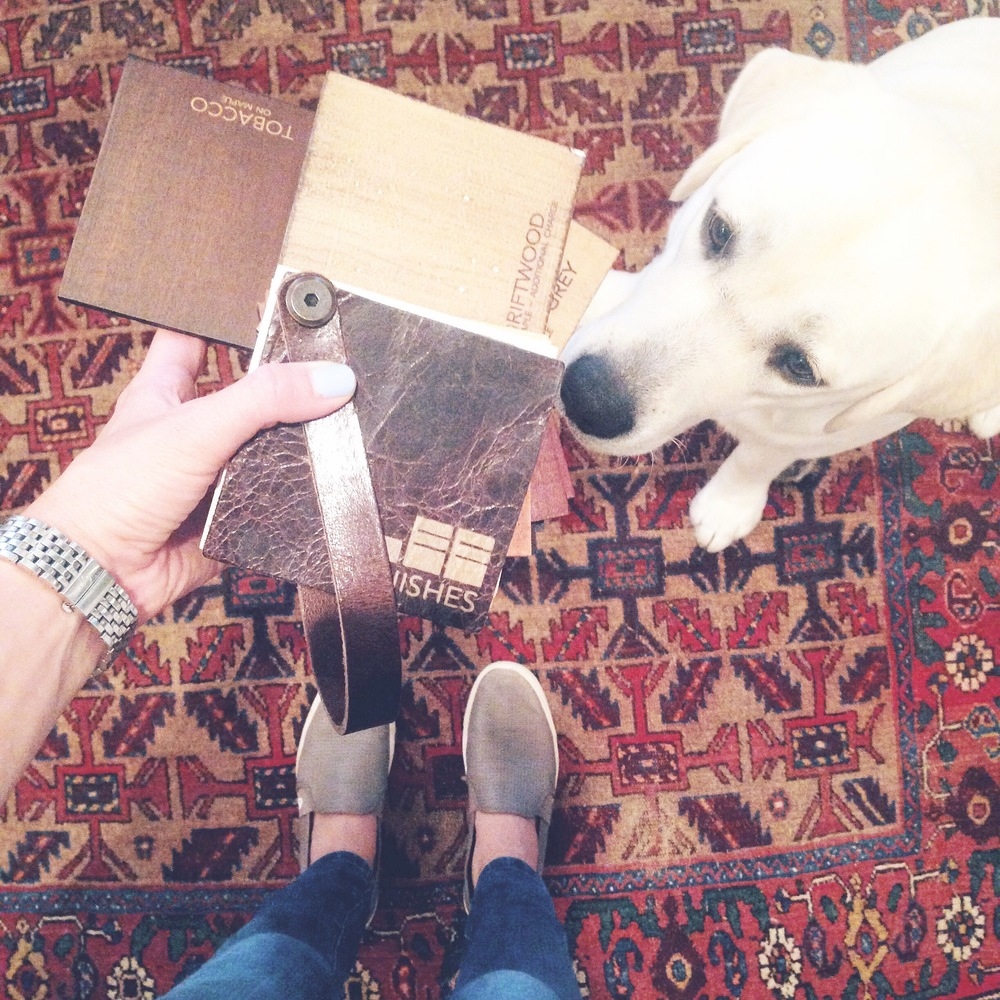 choosing barstool wood finishes for my parent's house.. eloise thought this was a new toy for her to chew on.