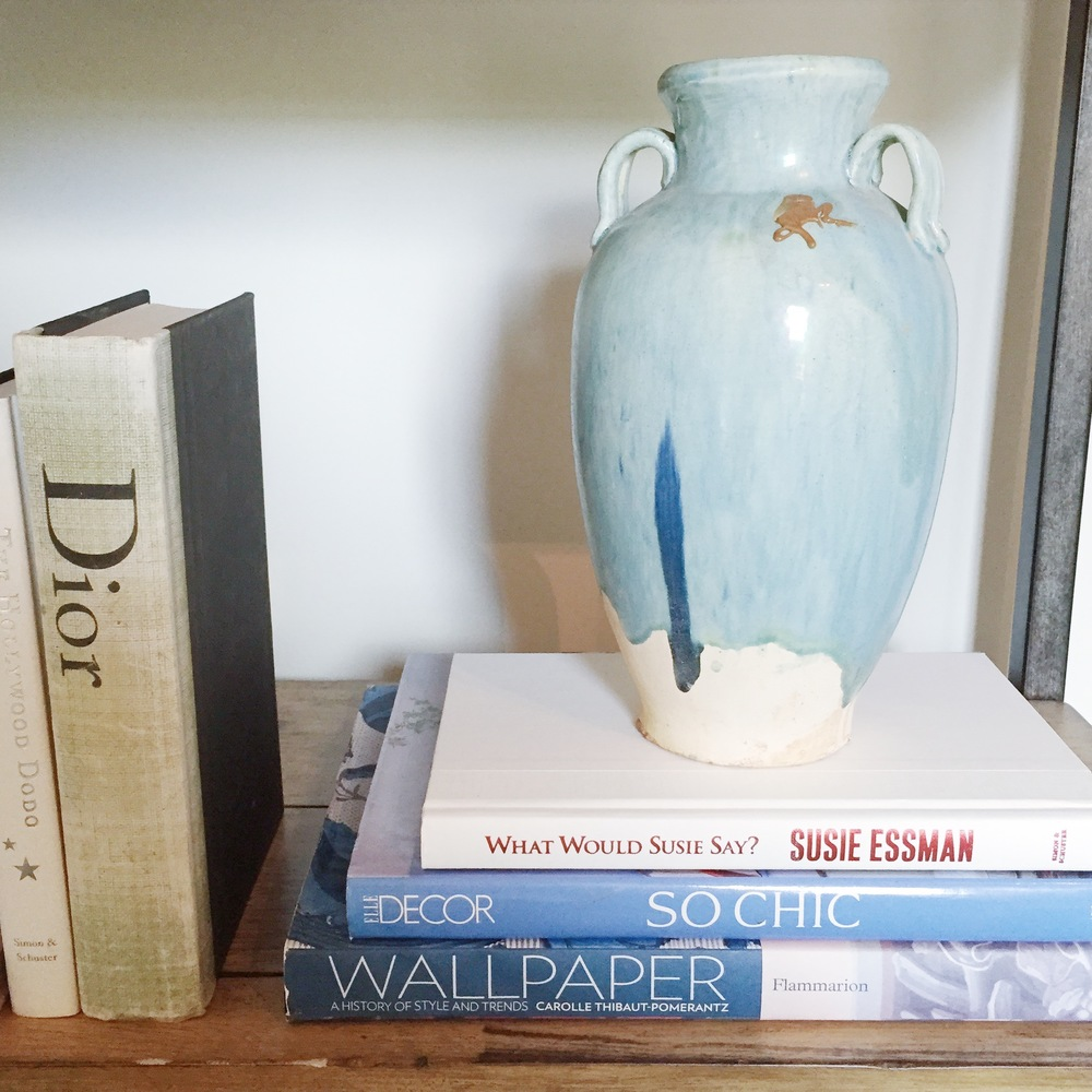 LOVED THE POPS OF BLUE MIXED INTO THE BOOKSHELVES