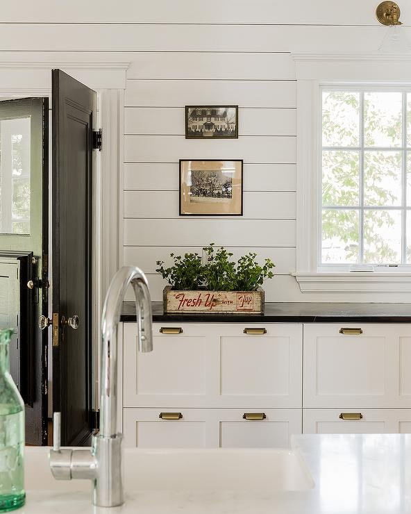 white-cottage-kitchen-cabinets-brass-vintage-cup-pulls-shiplap-backsplash-Sabbe-Interiors.jpg