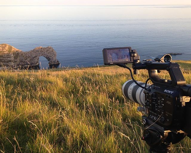 Rock Action. Filming sunset at Durdle Door yesterday evening. . . . #cinematography #videoproduction #sonyfs5 #canon70200mm #durdledoor #jurrasiccoast #rockaction #onlocation #sunset #landscape #southwestcoastpath #filmmaking #behindthescenes #sonyusers