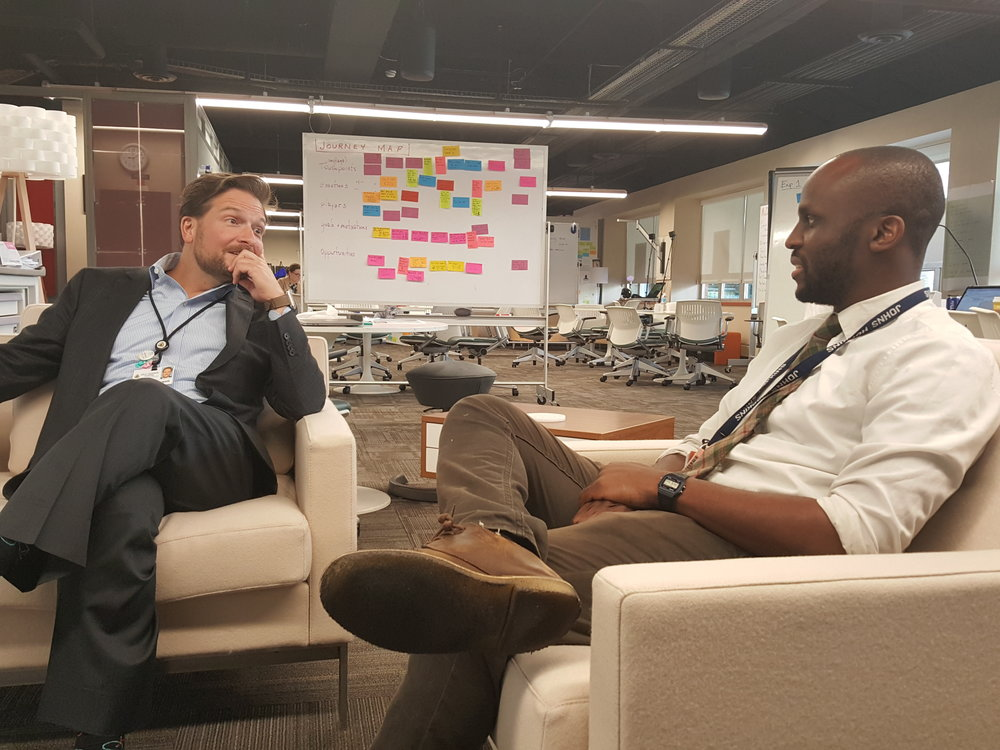 Dr. Jason Emejuru (right) meets with Director Nick Dawson in the Sibley Innovation Hub.