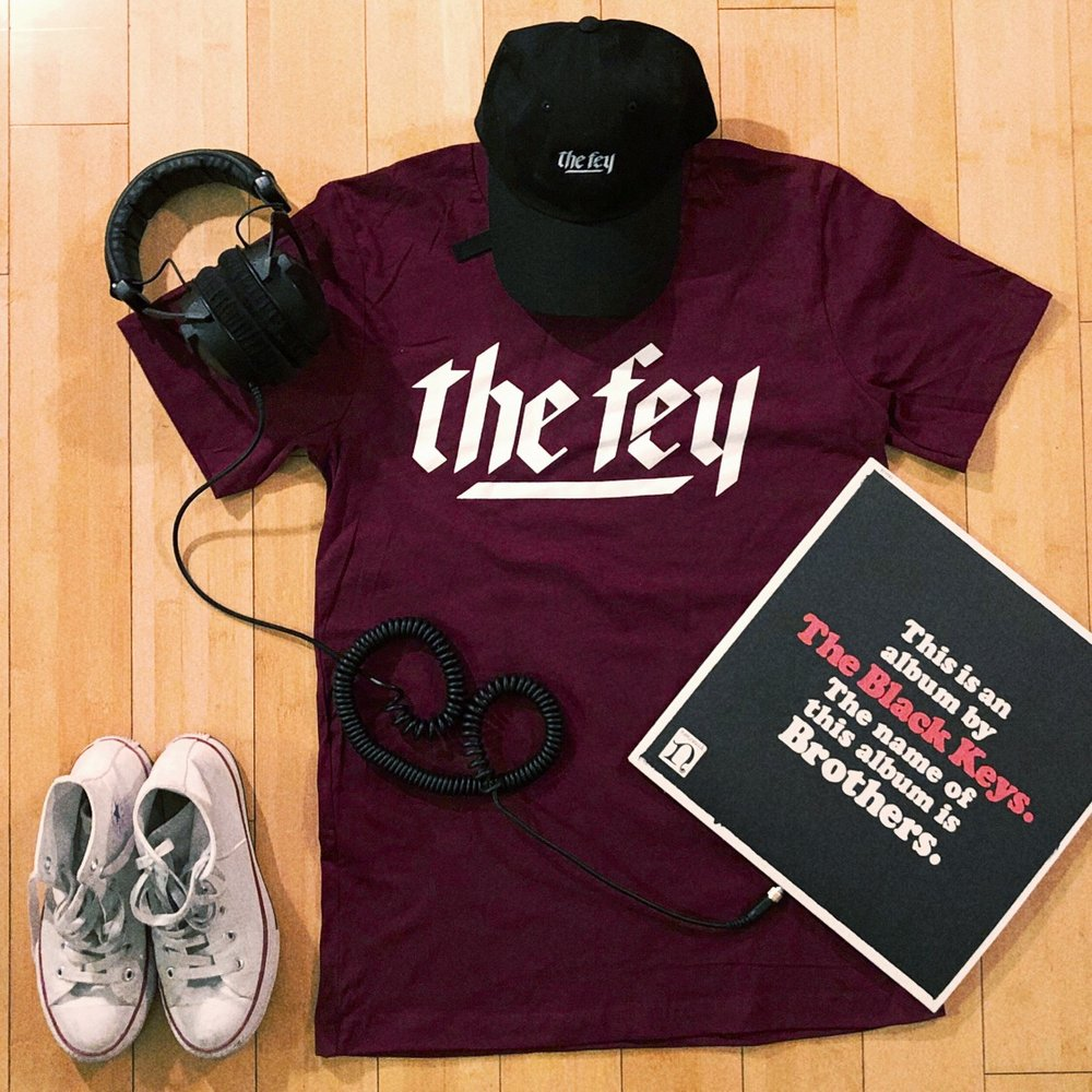 """THE FEY LOGO T-SHIRT IN MAROON   Clean, simple, fundamental… With a pop of color. White """"The Fey"""" logo on a maroon Next Level t-shirt."""