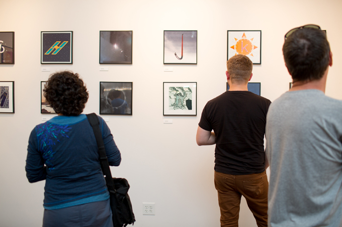 Guests checking out the cosmic art