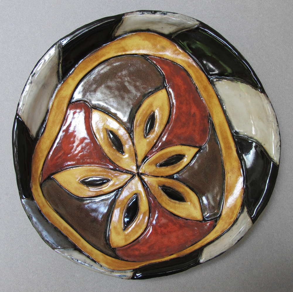 YELLOW AND BLACK FLOWER PLATE
