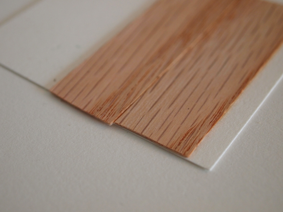 Side by side veneer, on the OPPOSITE side the veneer lays perpendicular