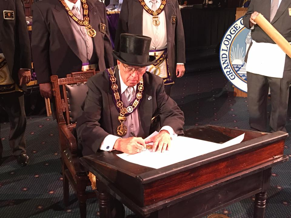 Grand Master William A. Reiners signs a charter for Speedway Lodge No. 500, F. & A. M.