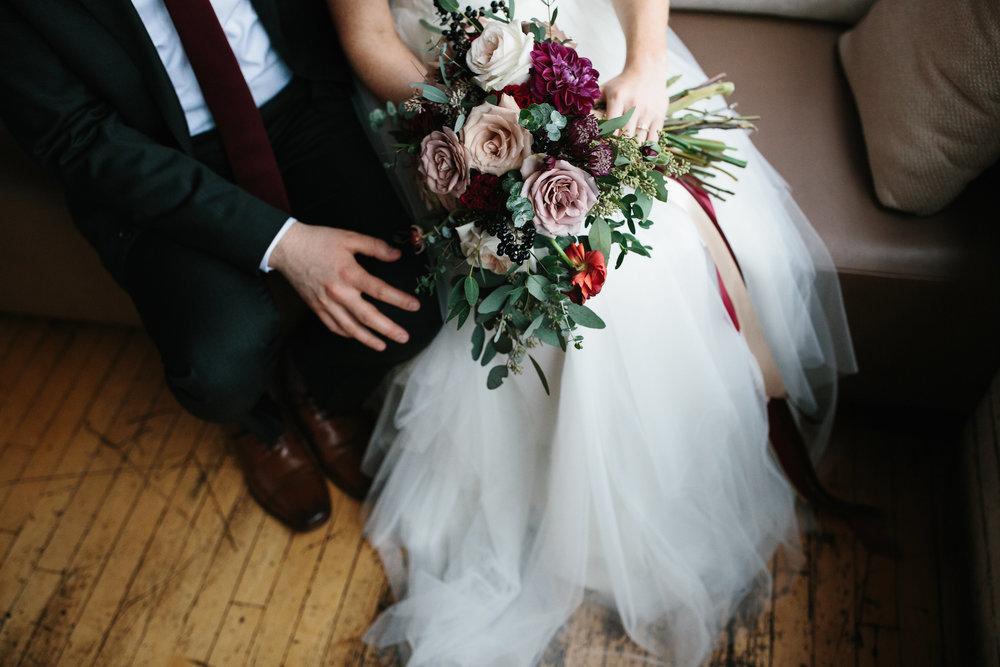 Maire&AshkonMarried-bouquet on lap.jpg