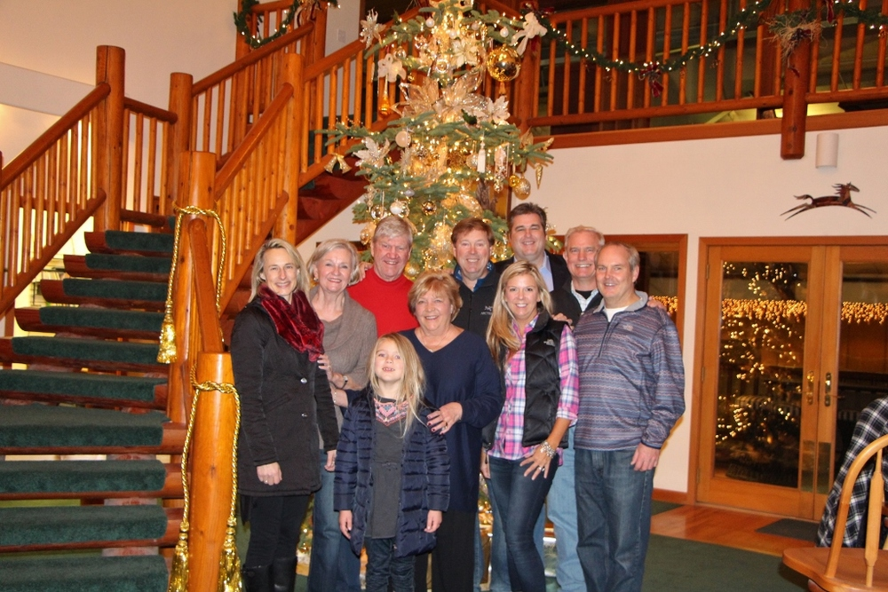 Above: Brad Vancour (Far Right) with Family & Close Friend
