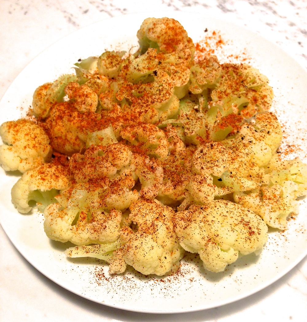 Steamed cauliflower with fresh black pepper, paprika, and cayenne.