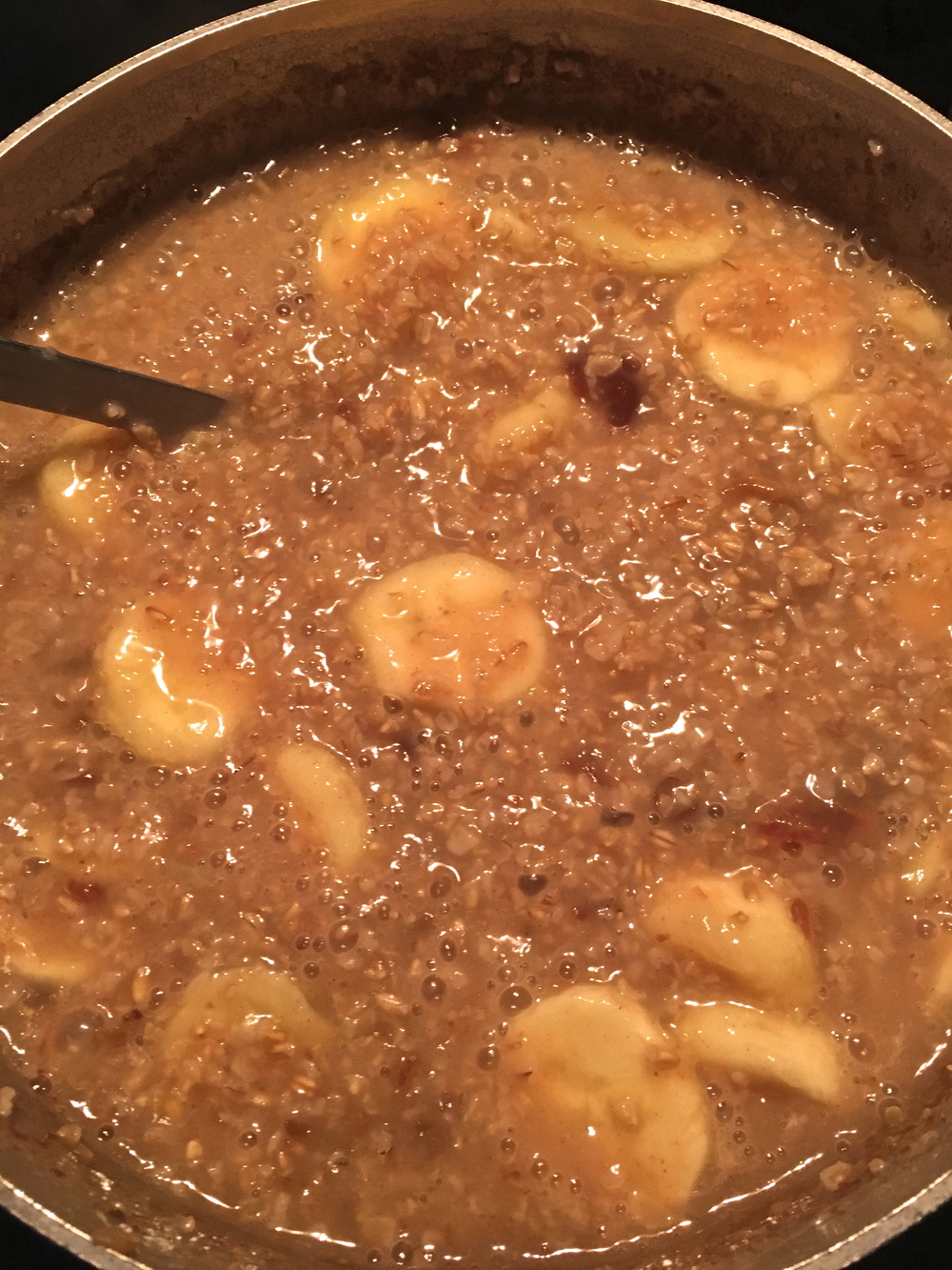 Steel-cut oatmeal is the go-to at the Homestead.  Here is a boiling pot with fresh banana and dates cooked inside (with cinnamon added).