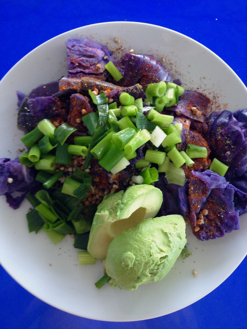 Steamed red cabbage with chopped scallions, avocado, kasha, and spices.