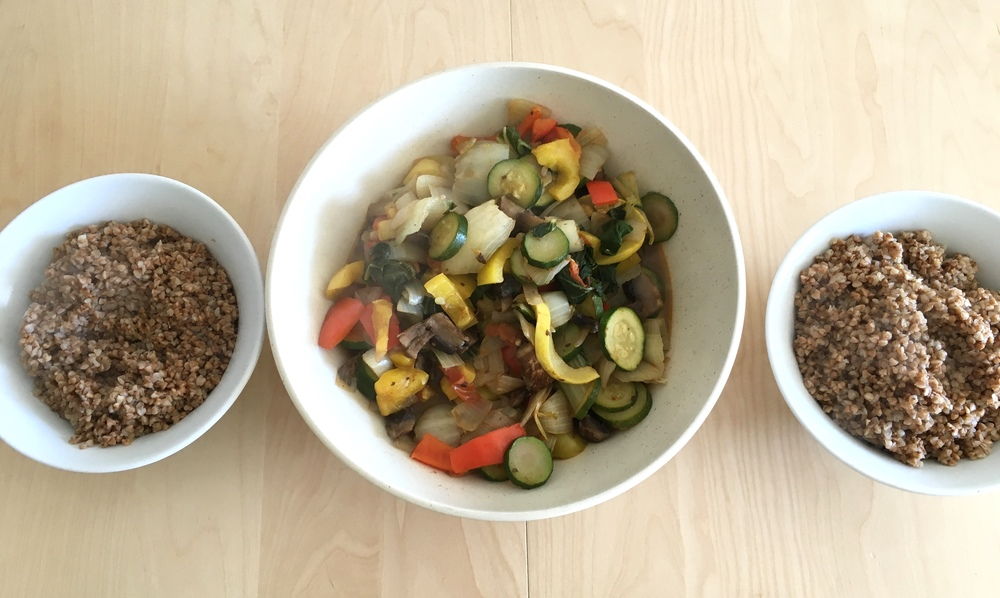 Instead of going out late, I spend my time on the weekends cooking healthy food -- usually preparing  batches that I can eat during the hectic hours of the week .  Here is a bowl of sauteed  vegetables  (squash, zucchini, peppers, onions, and mushrooms) alongside two bowls of hot kasha (buckwheat).