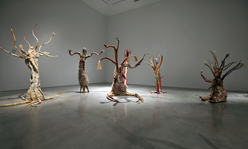 Tjanpi Desert Weavers ,  Minyma Punu Kungkarangkalpa , 2013. Installation view,  string theory: Focus on contemporary Australian art, MCA,  2013. Museum of Contemporary Art, purchased 2013. Image courtesy and © Tjanpi Desert Weavers, NPYWomen's Council. Photograph: Alex Davies