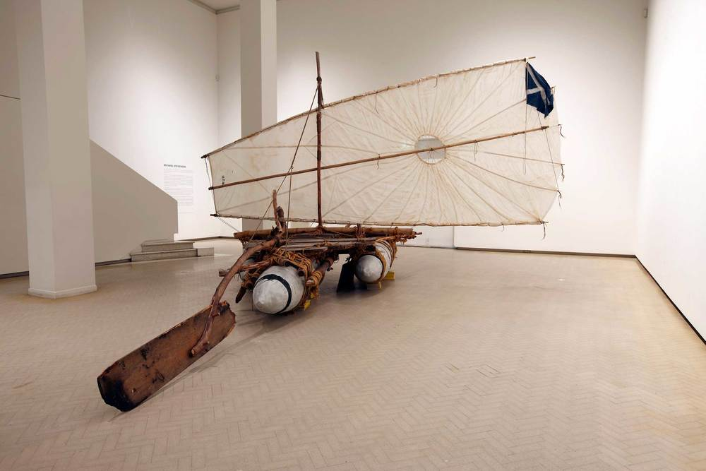 Michael Stevenson, The gift (from 'Argonauts of the Timor Sea'), 2004–06. Installation view, Michael Stevenson, Museum of Contemporary Art Australia, Sydney, 2011. Aluminium, wood, rope, bamboo, synthetic polymer paint, World War Two parachute and National Geographic magazines, 400 x 600 x 300 cm. Purchased 2007 by The Queensland Government's Gallery of Modern Art Acquisitions Fund. Collection: Queensland Art Gallery. Image courtesy the artist and Museum of Contemporary Art Australia © the artist