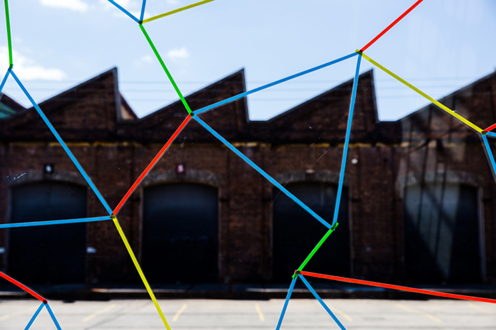 Helen Egar  Tracks  2015, adhesive tape, site specific installation. Courtesy the artist and Utopia Art Sydney, Sydney