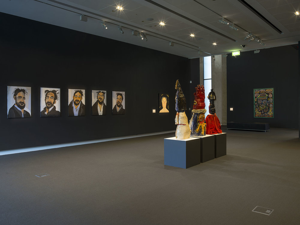 Installation view featuring work by Vincent Namitjira and Ramesh Mario Nithiyendran in the foreground.