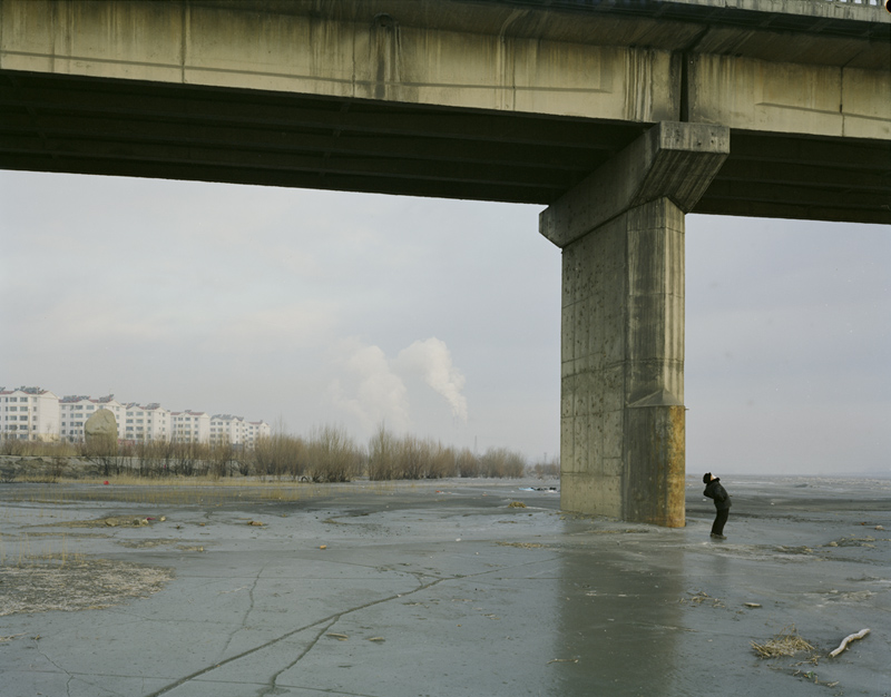 Man Doing Morning Exercise Under the Bridge with Mask, Ningxia, 2010