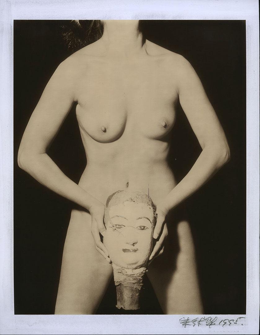 Nude holding a Buddha Head #52_1995.jpg