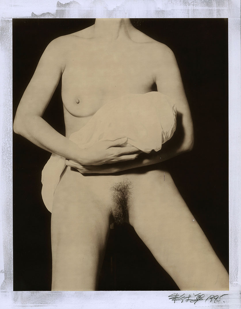 Nude holding a Buddha Head wrapped by a cloth  #54_1995.jpg