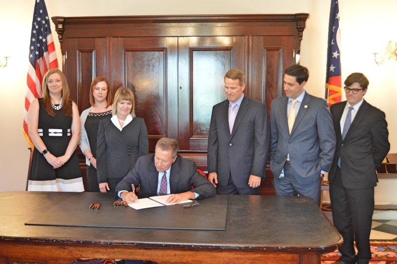 "From ohiosenate.gov - ""Senator LaRose (second from right) joins Secretary Husted (third from right) and local elections officials for signing of Senate Bill 63"""